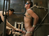 Sexy dude gets seized and tied up to get his cock and asshole tortured