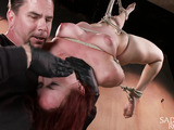 Tattooed red babe gets bound and painfully tortured