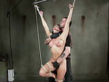 Big-titted ponytailed brunette gets suspended upside-down for flogging and tortures with ropes