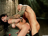 Encage brunette chick with big boobs and pierced nipples gets bound and tortured badly by kinky bald tattooed guy
