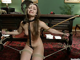 Long-haired chick with bushy snatch gets roped and gagged for bad jeering and fucking