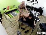 Small-titted brunette vixwn in a striped vest and high heels gets her twat creampied on the office desk