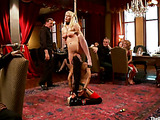 Long-haired blonde gets roped and suspended at the party for kinky guests jeer her and fuck