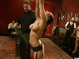 Busty gagged ponytailed brunette getting flogged when suspended before hard group pounding