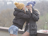 Brunette chick and her blonde BFF both in knitted hats and jacket come in the house to warm up with lesbian games
