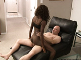 Skinny black babe in a black top riding a white meat backwards