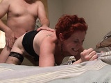Red matured whore in fishnet stockings and high boots enjoys fucking with a strange man