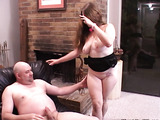 Busty ginger slut in a black dress with a gag-ball enjoys jumping on a cock
