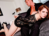 Blindfolded brunette vixen in a black lace dress giving a deep throat blowjob