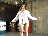 Ponytailed Japanese doll in a white shirt skipping shaking her huge juggs