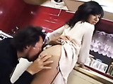 Horny dude teasing Japanese hot mom in a white skirt and blouse in the kitchen