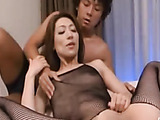 Seductive Japanese mom in a fishnet catsuit pleasing two dudes