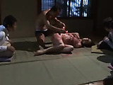 Tied harlot gets a taste of molted red wax on a grey mat indoors.