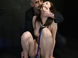 Astounding busty nude chained girl gets striped by a horny guy.