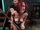 Red chick gets spanked and tortured with electricity during rough sex in bondage