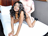 Tattooed ebony girl in a blue dress tugging a white dick till explosion onto her fresh boobies