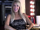 Experienced blonde mature whore in a sexy black dress talking about her preferences