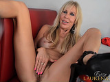 Horny blonde mature takes off her G-string to toy her snatch in the kitchen