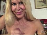 Blonde mature chick gives an intensive handjob to a dude
