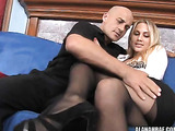 Busty blonde hooker gets her cunt penetrated through her black torn pantyhose