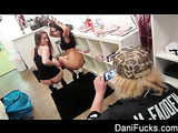 Long-haired brunette chick in a black vest and G-string and her Asian friend get ready for shooting