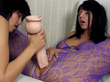 Brunette dyke in purple lace tights gets her cunt worked out with a huge dildo