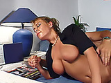 Diva in a black top takes a load of spunk on her tits in the living room.