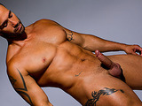 Tattooed hung gets dirty during his photo shoot