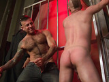 Small naked hunk dude makes out with a hairy tattooed stud in jeans before he lets him whip his butt then licks his ass before he gives him and a masked dude in a long black coat a blowjob then he shoves both of their cocks together in his mouth before he