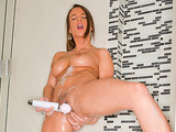 Stunning brunette is soaped up in the shower and shaves after using her powerful Hitachi Magic Wand.