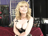 Shapely busty milf in black corset and stockings ride and suck black cock on bed