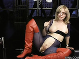 Sexy milf in glasses, red boots, purple mesh top and ripped pantyhose fucks dildo