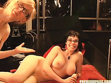 Milf in glasses and black pantyhose fucks hot brunette in glasses with strap-on