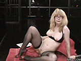 Tasty sexy milf in glasses and black lingerie spreads legs and plays with pussy