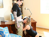 Tattooed guy helps a dirty blonde out of her black bra while his dick is in her mouth.