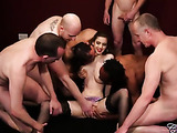 Skinny chick lets a bunch of naked dudes mash and suck her big soggy boobs before she lets them take off her purple panty and rub her sweet pussy wearing black stockings and high heels.