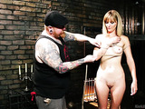 Naked model gets tied up in an introduction to asymmetrical bondage at the dungeon.