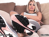 Amazing blonde buxom posing in sneakers, socks and bare feet