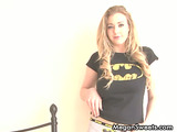 Fascinating diva in a bat signal shirt stripping on white sheets.