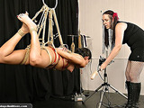 Tied up beauty gets whipped by rude female dominator