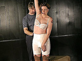 Short-haired woman in old-fashioned lingerie can not push her hand down