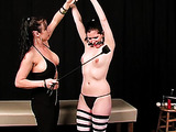 Chick in black panties and striped stockings enjoys BDSM