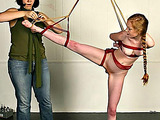 Cute babe with red hair gets tied up by dominatrix
