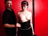 Mistress takes of her black dress following instructions