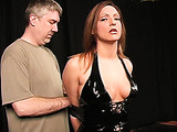 Big-boobied lady in latex costume enjoys BDSM action