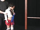 Short-haired brunette in cute skirt gets spanked hard