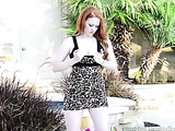 Redhead hottie peels down her black and brown leopard dress and shows her huge boobs before she spreads her legs wide and screws her crack with a violet dildo beside the pool.