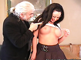 Slutty brunette with hot tits spanked by an elder man