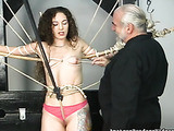 Petite chick with beautiful hair takes part in BDSM action