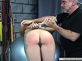 Tied honey with curly hair enjoys taking part in BDSM scene